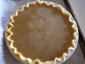 Pumpkin pie ready for baking