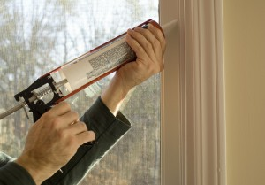 person caulking window1
