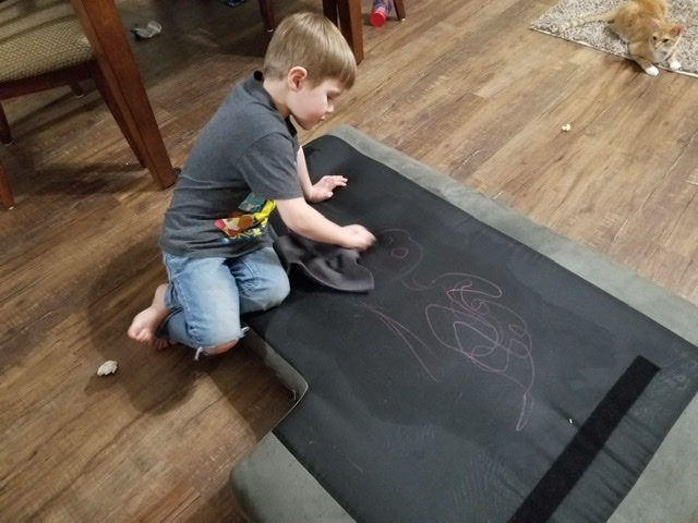 Child cleaning crayon stain