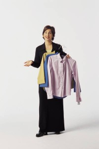 Woman holding clothes on a hanger