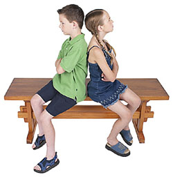 Two_school_age_boy_and_girl_not_getting_along275pixels