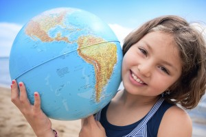 Smiling School Age Girl Holding Globe
