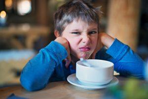 boy refusing to eat food