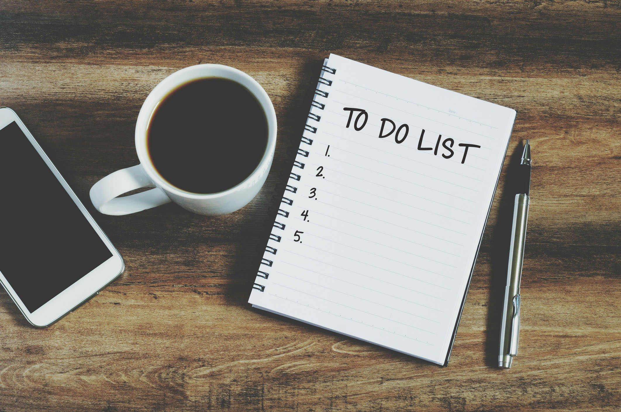 "Smart phone, coffee, pen and notepad with text "" to do list"", retro style"