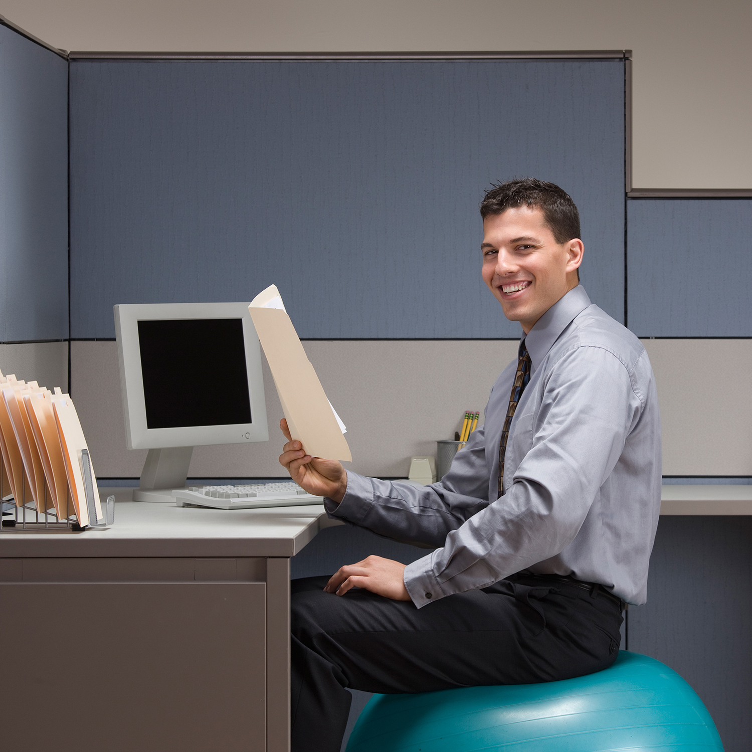man as desk exercise ball