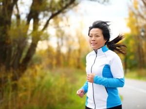 adult woman running outside fitness active exercise