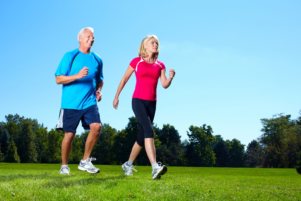 elderly couple walking fitness active