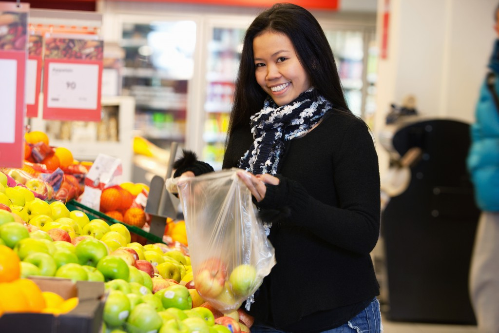 woman grocery store shopping produce