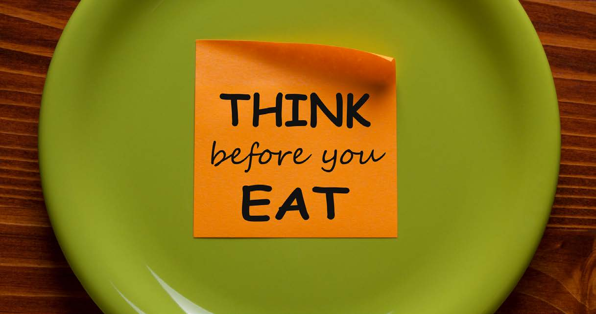 """Think before you eat"" post-it on a plate"
