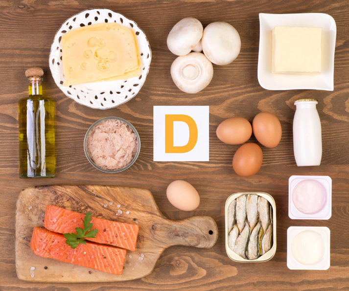 Vitamin D rich foods including oil, butter, eggs, cheese, milk, fish