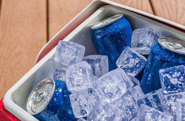 Cooler with ice and beverage cans