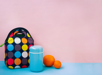 Lunch bag with drink and fruit