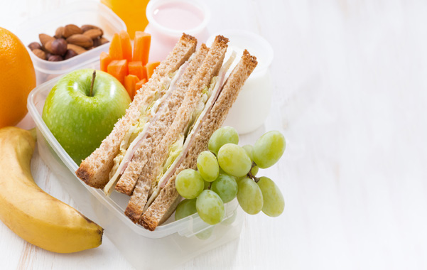packed lunch with sandwich and fruit