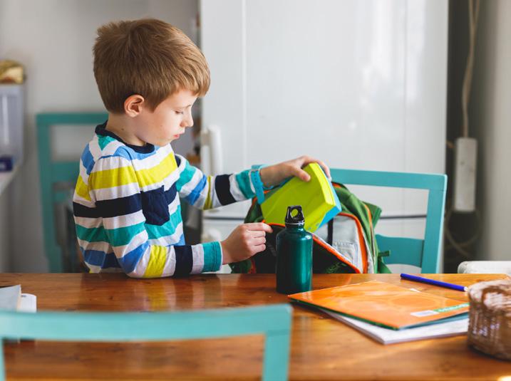Boy opening a school lunch
